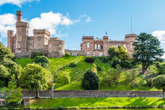 Side view of Inverness Castle. INVERNESS, HIGHLAND, SCOTLAND - SEPTEMBER 20, 2014: sunny, bright hdr of Sheriff Court, Inverness Castle, under blue sky. The Royalty Free Stock Images