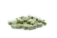 Raw Organic Kamut Grass Pills Royalty Free Stock Photo