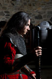 Side View of Knight Praying Before the Battle Against Stone Wall. Side View of Knight Praying Before the Battle Against Old Stone Wall Royalty Free Stock Photos