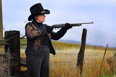 Side View Lady Gunman Stock Photos