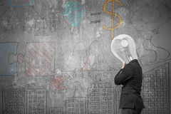 Side view lamp head businessman thinking with business doodles Royalty Free Stock Image