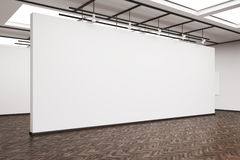 Side view of a large blank wall in an art gallery with dark wood Stock Image