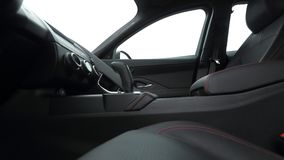 Side view of leather car interior stitching red thread stock photo