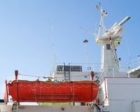 Life boat on a ship. Side view of a life boat on a commercial shipping vessel Stock Photography