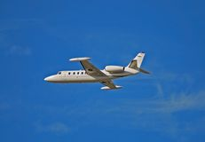 Side view of light white colored jet airplane Royalty Free Stock Photos