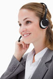Side view of listening call center agent with headset on Royalty Free Stock Photos
