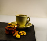 Side view on little black coffee with nut muffin, walnuts, almon Royalty Free Stock Images