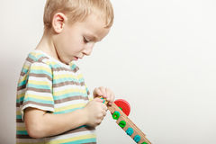 Side view little boy play with toy. Stock Photo