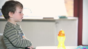 Side view of little boy watching TV, stock footage Royalty Free Stock Image