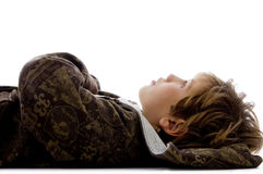 Side view of little kid resting on floor Stock Photography