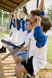 Side view little league baseball team cheering Stock Photo