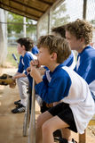 Side view little league baseball team waiting to bat Royalty Free Stock Image