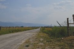 The side view of the long country road. stock photos