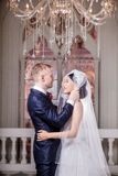 Side view of loving wedding couple looking at each other in church Stock Photography