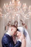Side view of loving wedding couple standing head to head in church Stock Photos
