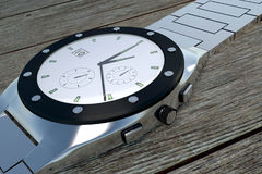 Side view of a luxury stainless steel wristwatch Royalty Free Stock Photos