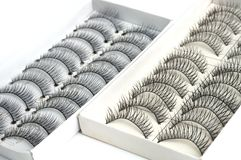 Eyelash extensions photo taken from the side. A side view macro photo taken on some eyelash extensions in opened boxes stock photos
