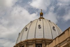 Side view of the main dome of the Basilica of Our Lady of Peace with the setting sun to the west Stock Photos