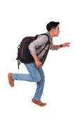 Side View Male Asian Student Running Forward Royalty Free Stock Image