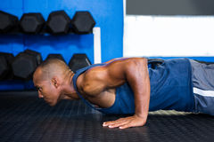 Side view of male athlete doing push-ups Royalty Free Stock Photo
