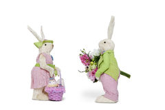 Side view of male Bunny with flower bouquet and female Rabbit over white background Stock Image