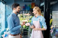 Florist and client with credit card Royalty Free Stock Images