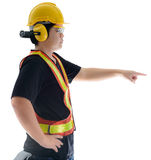 Side view of male construction worker with Standard construction Royalty Free Stock Images