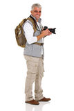 Side view male tourist. Cheerful side view of senior male tourist on white background royalty free stock photo