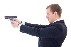 Side view of man in business suit shooting with gun isolated on Royalty Free Stock Image