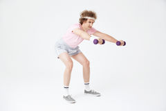 Side view of man doing squats, building muscles, training hard Stock Image
