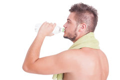 Side view of man drinking water as summer dehydration concept Royalty Free Stock Image