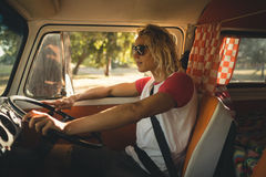 Side view of man driving camper van. Side view of man wearing sunglasses while driving camper van Royalty Free Stock Image