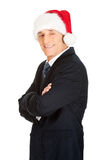 Side view man with folded arms wearing santa hat. Side view businessman with folded arms wearing santa hat Royalty Free Stock Image