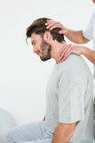 Side view of a man getting the neck adjustment done Stock Photography