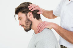 Side view of a man getting the neck adjustment done Stock Images