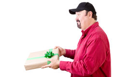 Side view of man giving or receiving a gift Royalty Free Stock Photography