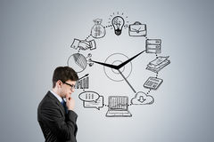 Side view of man in glasses and business clock Stock Images