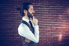 Side view  man with hand on chin thinking Stock Images