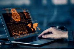 Hacker concept. Side view of man hands using laptop with abstract digital padlock hologram on screen. Hacker concept stock image