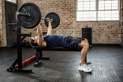 Side view of a man lifting barbell Royalty Free Stock Image