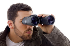 Side view of man looking through binoculars Stock Images