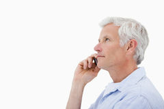 Side view of a man making a phone call Royalty Free Stock Photos