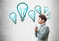 Side view of man with marker and light bulbs Stock Images