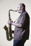 Side View Of Man Playing Saxophone Royalty Free Stock Image