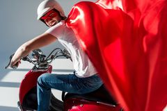 side view of man in protective helmet and superhero costume royalty free stock image