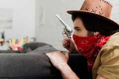 side view of man in red bandana and cowboy stock photography