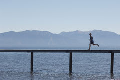 Side View Of Man Running Along Pier Royalty Free Stock Photography