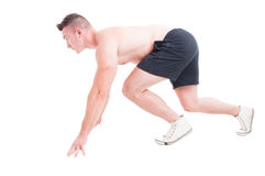 Side view of a man in running start position. Isolated on white Royalty Free Stock Photo