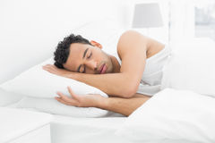 Side view of a man sleeping in bed Royalty Free Stock Images
