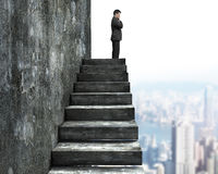 Side view of man standing on top of concrete stairs Stock Images